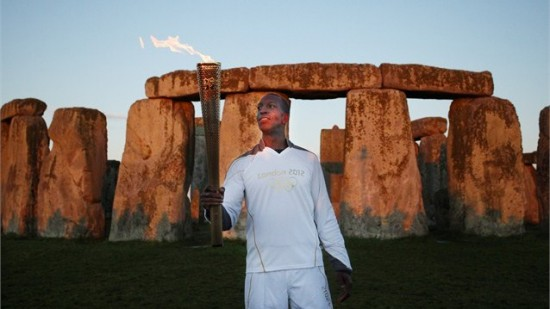 Michael Johnson at Stonehenge with Olympic Torch