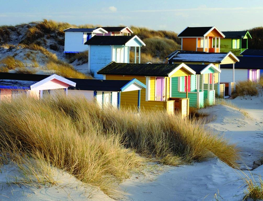 Colourful beach huts in Scandinavia