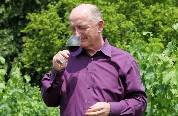 Oz Clarke drinking wine in vineyard