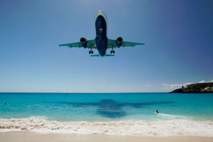 Take-off and landing over the blue ocean at St Maarten