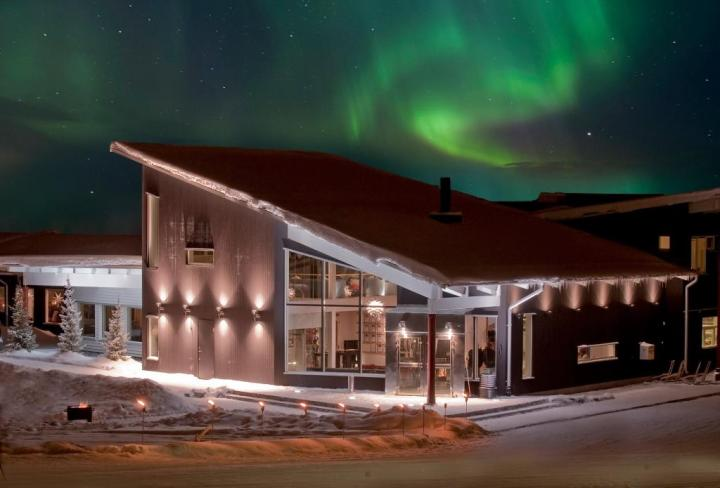 Ripan Hotel, Lapland with Northern Lights above.