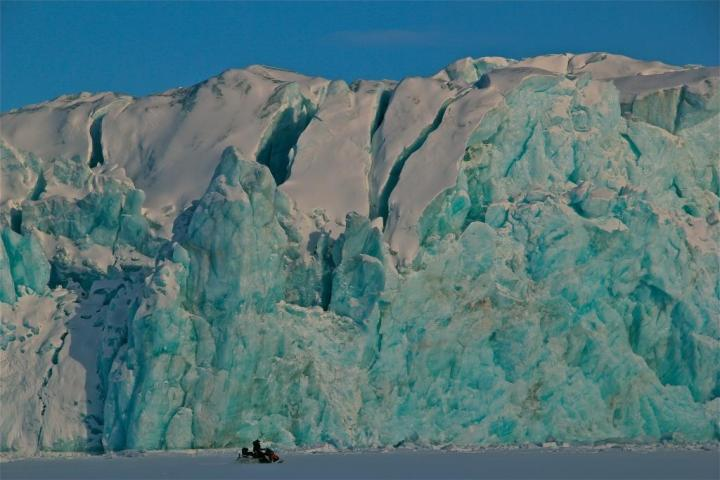 snow mobiling across the majestic mountains of Svalbard