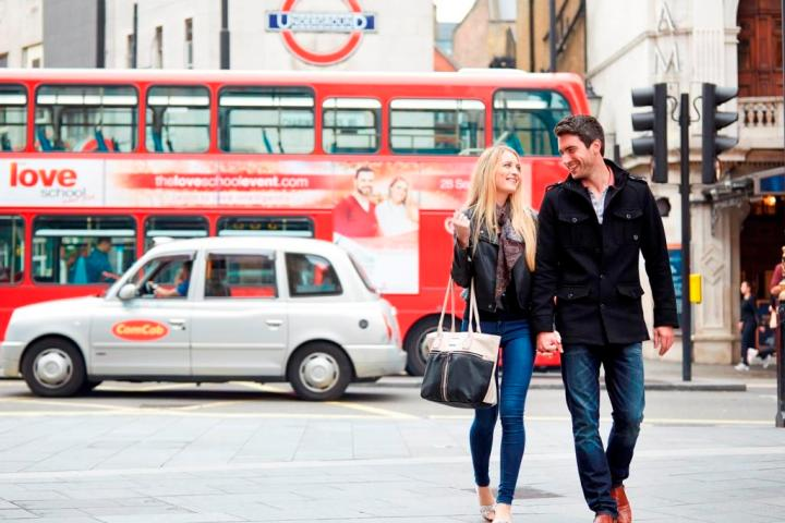 Married couple walking in West End, London